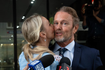 Craig McLachlan is kissed by his partner, Vanessa Scammell, after a not guilty verdict in his sexual assault trial.