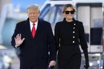 President Donald Trump and first lady Melania Trump arrive at Joint Base Andrews.