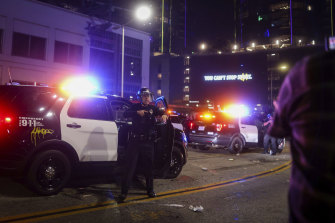 Police officers try to disperse rowdy Lakers fans.