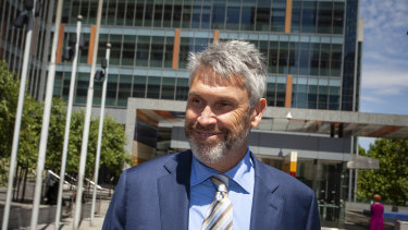David Gyngell leaves court after five minutes in the witness box after flying in from Byron Bay to give evidence in the civil penalty proceeding brought against Harold Mitchell and Steve Healy.