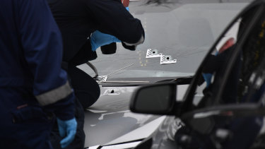 Police at the scene of the Tullamarine shooting on Friday.