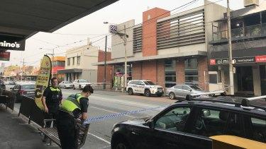 A man allegedly damaged a police car on Sydney Road.
