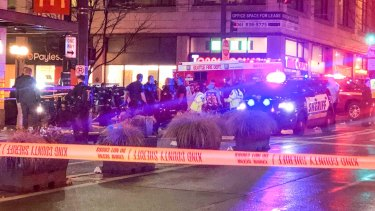 Police work the scene of a shooting on Third Avenue and Pine Street in Seattle.