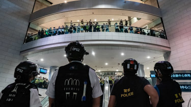 Hong Kong police face off against protesters in a shopping centre in April this year.