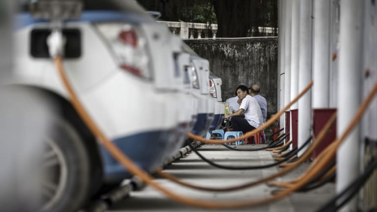 Electric taxis are pictured recharging in China. Chile will look to introduce more electric charging points to meet what the government hopes will be a growing demand for electric vehicles.
