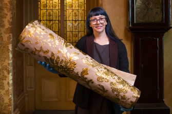 National Trust curator Elizabeth Anya-Petrivna with samples of the replica  Japanese wallpaper she hopes will be pasted on a wall at Rippon Lea.