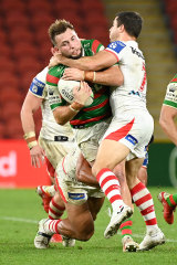 The Dragons halfback makes a tackle on Sunday night.