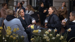People chat and drink in Stockholm, which has not experienced the same lockdowns imposed on other European cities.