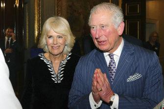 "Prince Charles using the ""namaste"" greeting."