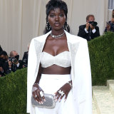 Adut Akech Bior, raised in Adelaide, wore a Michael Kors suit with a diamond encrusted crop top to the Met Gala.