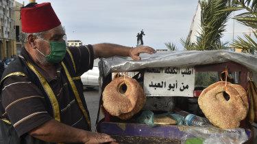 Street vendor Abu al-Abed sells kaak breadstuff  successful  Beirut.