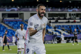 Karim Benzema celebrates the second goal of his first-half double for Real Madrid.
