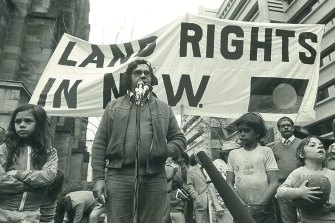 Yvonne Weldon, pictured left, stands next to her uncle, the Indigenous activist Paul Coe, as he speaks at a protest in 1978.