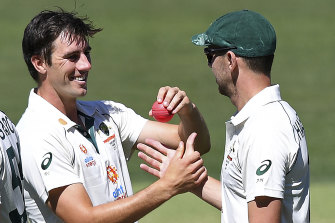 On fire: Josh Hazlewood, right, and Pat Cummins, left, were on song against India on Saturday.
