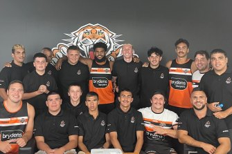 Indigenous Wests Tigers players, including James Roberts and Daine Laurie, talk about the opportunities at the club with a group from Awabakal, an Indigenous medical service.