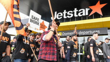 Jetstar workers on strike at Melbourne airport on Friday.