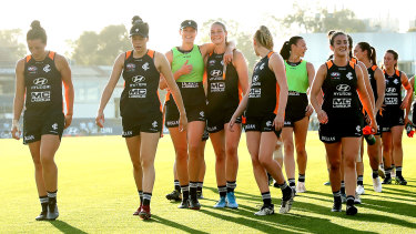 Harris (fourth from left) on the track with her fellow Blues.