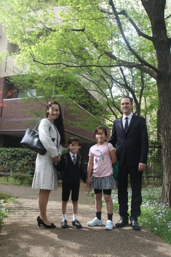 Scott McIntyre with his wife, Naoko, and their two children in happier times. He has not seen his kidssince last May, when they went to stay with their Japanese grandparents for a night and never returned.