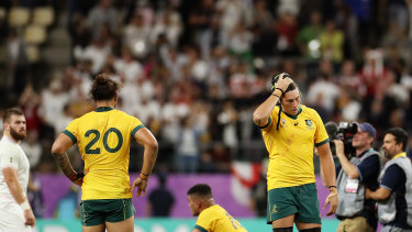 Burden of defeat: The Wallabies reel after their heavy quarter-final loss to England.