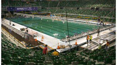 Builders complete works on a temporary swimming pool at Rod Laver Arena in 2007.