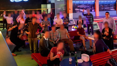 David Reid, standing right, at a work function at a Sydney bowling alley.
