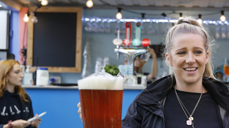 'Beautiful to have a pint': England's pubs, restaurants and hairdressers reopen