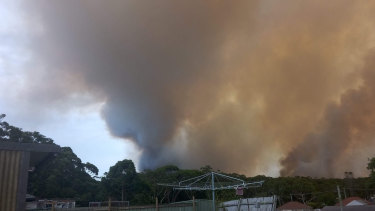 An out of control fire is burning through bushland in Booderee National Park.