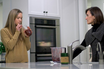 Nina Nichols, 18, takes her daily dose of Palforzia, mixed in a smoothie, as her mother, Maria Acebal watches, in her home in Washington.