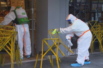 A Covid cleaning crew started early on Thursday morning at one of Melbourne's exposure sites,   Katialo restaurant in the Eaton Mall in Oakleigh.