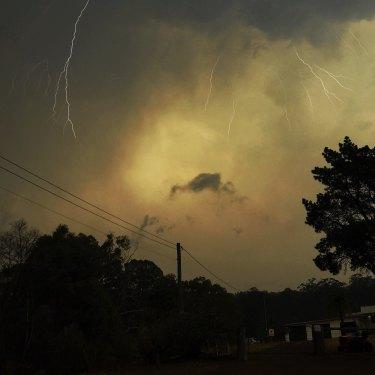 Lightning breaks through while bushfires rage nearby.