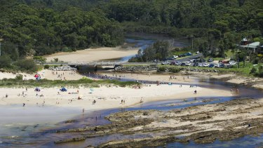 Emergency services were called to the beachside town of Broulee on the NSW South Coast, where a crime scene was established.