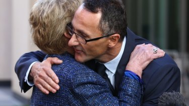 Former Greens Leader Senator Christine Milne embraces new Greens Leader Senator Richard Di Natale leader during a press conference in Parliament House in May 2015.