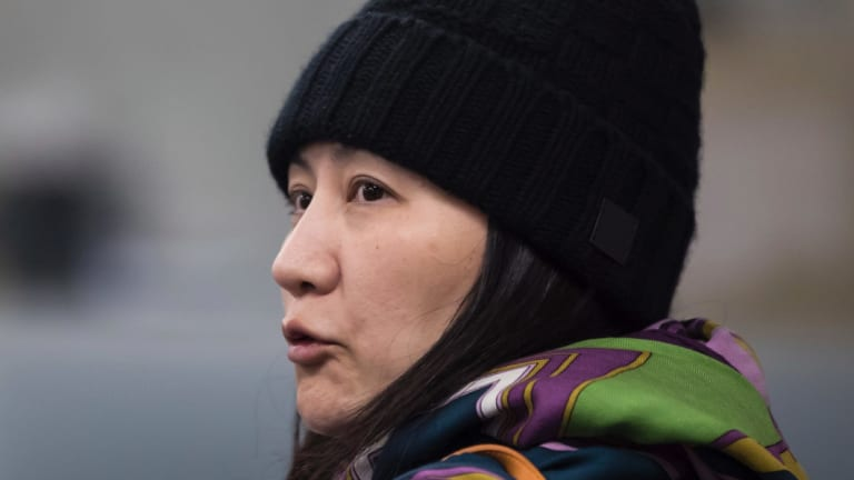 Huawei chief financial officer Meng Wanzhou talks with a member of her private security detail in Vancouver.