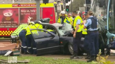 Paramedics and fire crews work to free the woman and the girl from the wreckage.