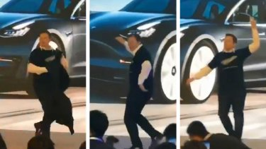 Tesla CEO Elon Musk dances his way through the launch of the new cars built at the China plant.