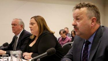 Warren Wilmot (right), the boss of OTR, at a senate inquiry when he was CEO of 7-Eleven.