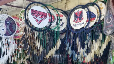 Dreamcatchers decorated with AFL logos targeting Australian tourists at a shop in Kuta.