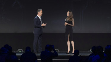 Walt Disney Studios president Sean Bailey talks to Angelina Jolie on stage at D23.