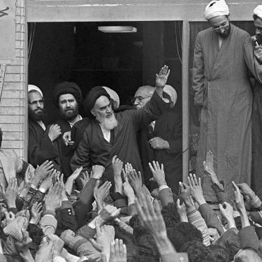 The Ayatollah Ruhollah Khomeini waves to followers in Tehran in 1979.