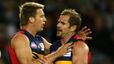 Mark Ricciuto, right, during his playing days for Adelaide.