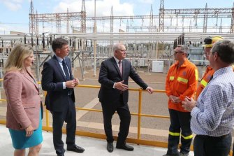 Prime Minister Scott Morrison (centre) visits the Tomago aluminium smelter near Newcastle with AngusTaylor, the MinisterforEnergyand Emissions Reduction (second from left), in September.