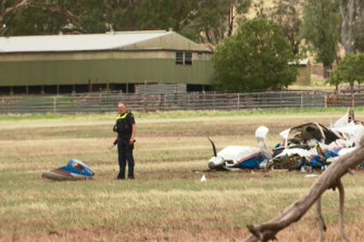 Police are investigating the cause of the fatal mid-air collision.