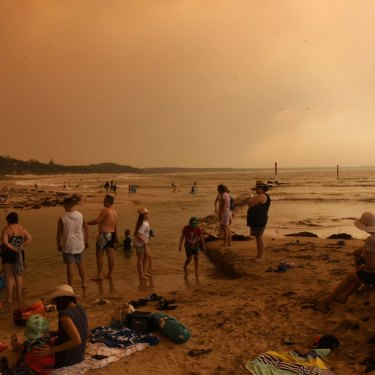 Holidaymakers on the beach at Currarong on December 31.