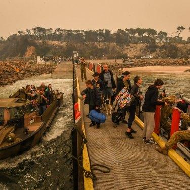 Evacuees prepare to leave Mallacoota on January 3.