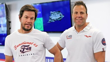 F45 ownerRob Deutsch, right, with actor Mark Wahlberg, who signed up to the company earlier this year after a sale process run by Deutsche Bank.