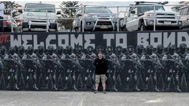 Luke Cornish with the mural before it was defaced.