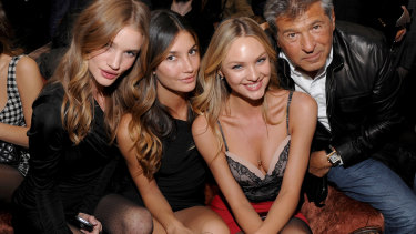 Models Rosie Huntington-Whiteley, Lily Aldridge, Candice Swanepoel and company executive Ed Razek at a Victoria's Secret in New York in 2009.
