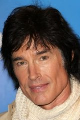 "Actor Ronn Moss has two adult daughters but is in no rush for grandchildren, telling his daughters to ""go out and enjoy your lives""."